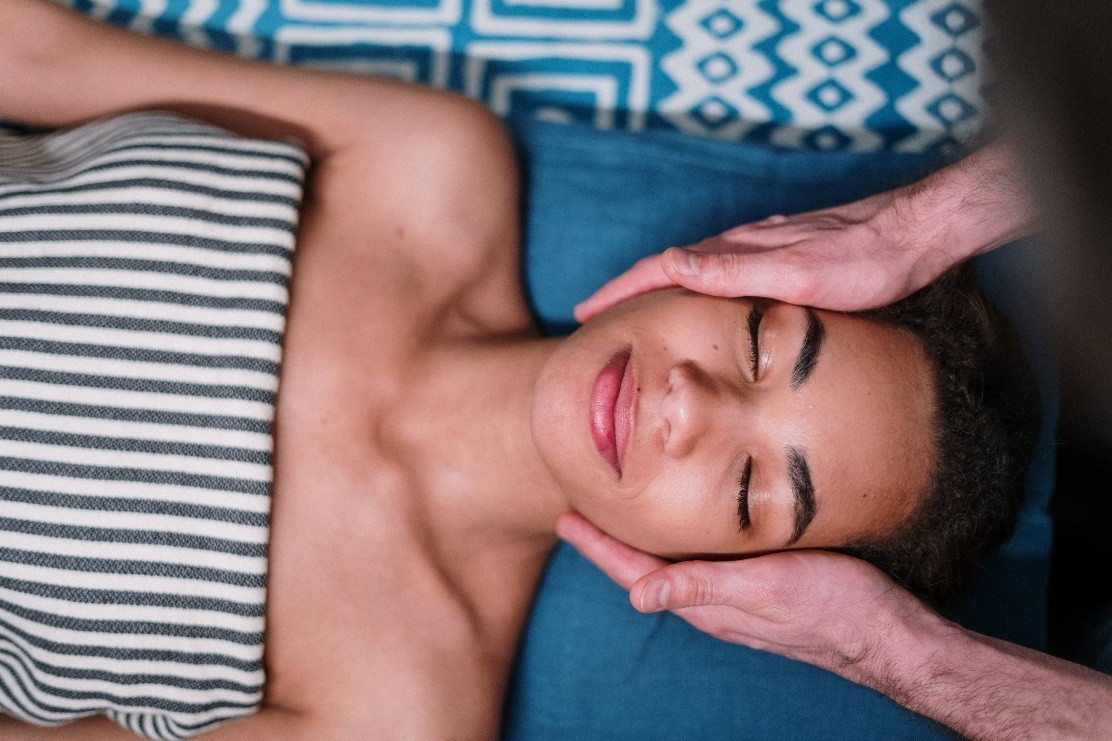 a woman is enjoying a relaxing facial in her me-time