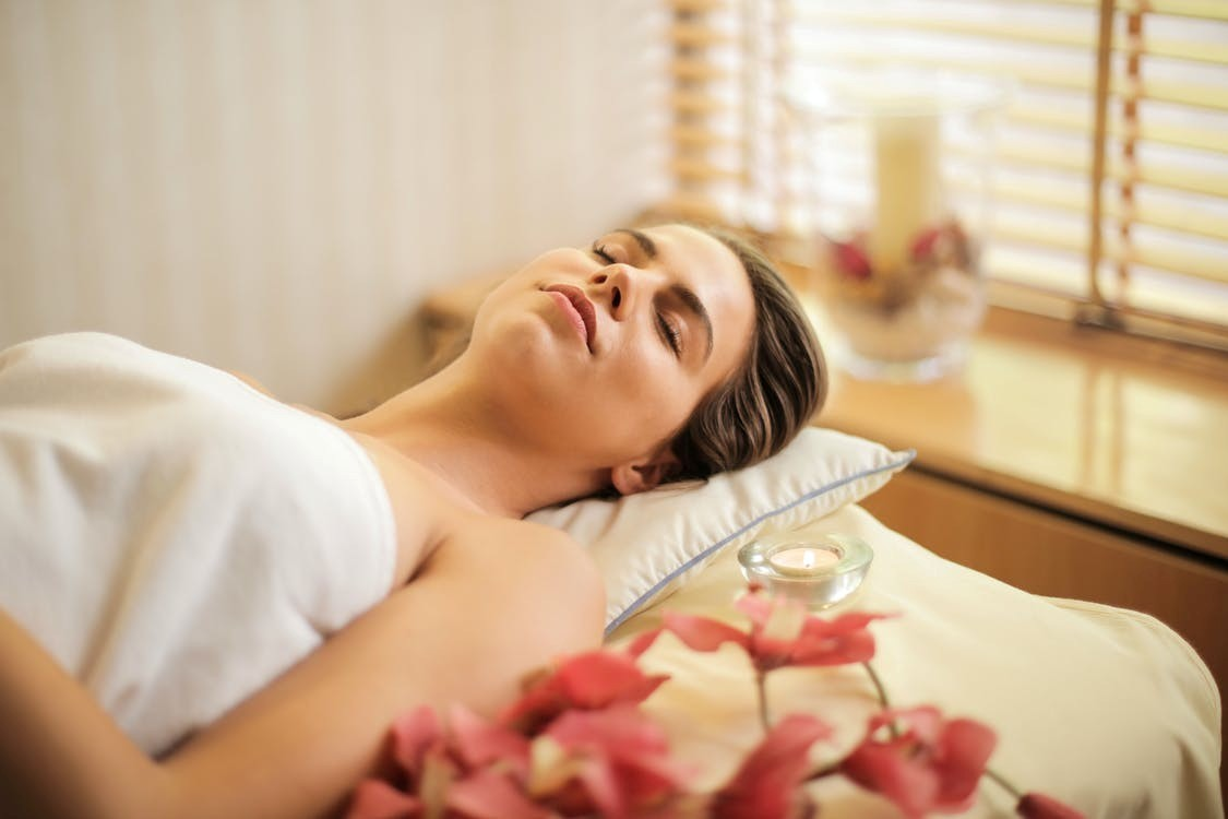 Woman feeling relaxed after a deep tissue massage.