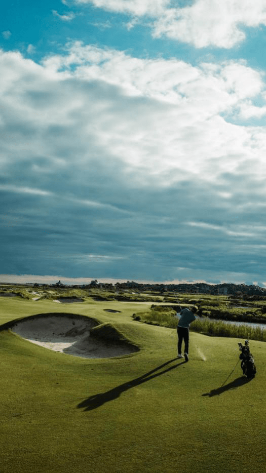 Golfer practicing his shot.