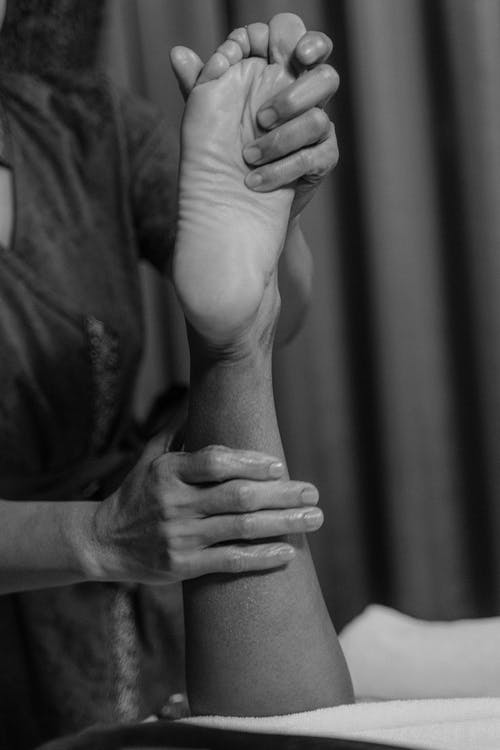 Sports massage for a foot injury.