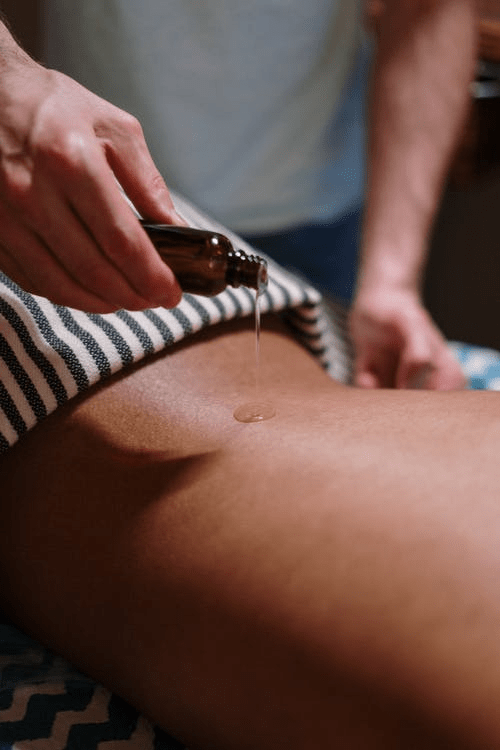 Massage oil being applied.